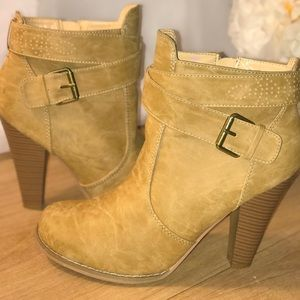 Tan high heeled booties.